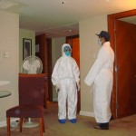 The hazmat suits appear at midnight. (Eric in the robe.)