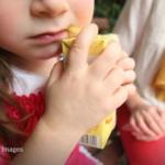 Child drinking fruit juice