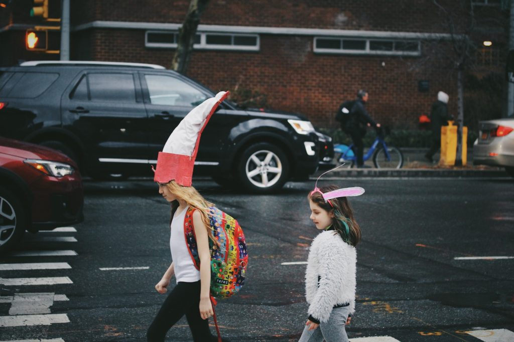 kids on way to school in goofy hats