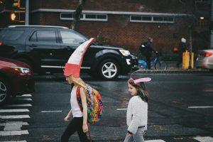 kids on way to school in goofy hats